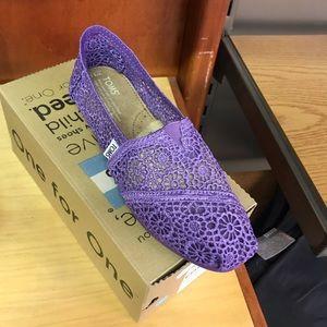 Purple Crochet Toms shoes.